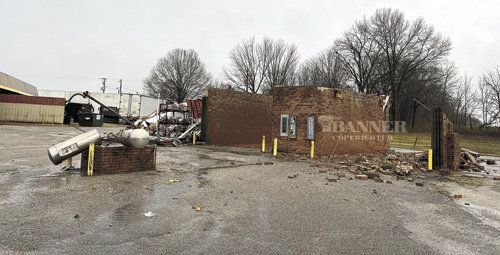 The roof is missing and the brick wall was destroyed at the car wash behind Master Muffler in Gleason.