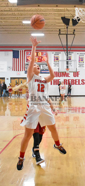 Lady Rebel (and Homecoming Queen) Shelby Davis scores on a fast break. Davis scored 15 points in McKenzie's win.
