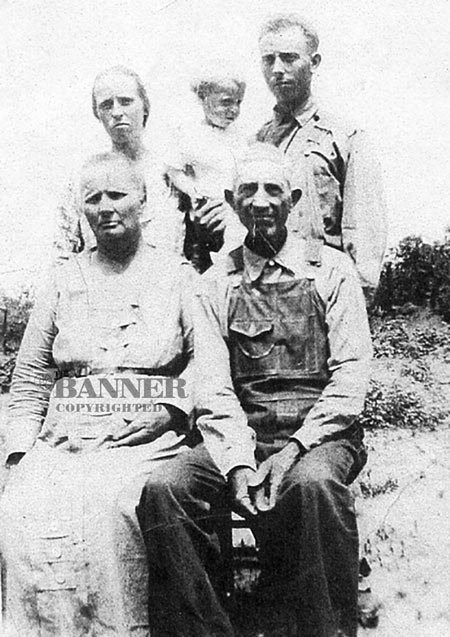 Mary Helen Linton Washburn and William (Billy) Daniel Washburn are shown seated in a photograph taken about 1924 in Henderson County, Tennessee. Standing behind them is Dovie Ardell Ross Washburn and Vester Arden Washburn. Vester is holding their oldest son, Fred Arden Washburn.