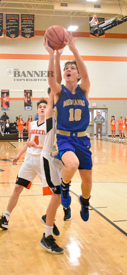 Mustang Grant Bartholomew goes strong to the basket for two points. Bartholomew led Huntingdon with 22 points in the win.