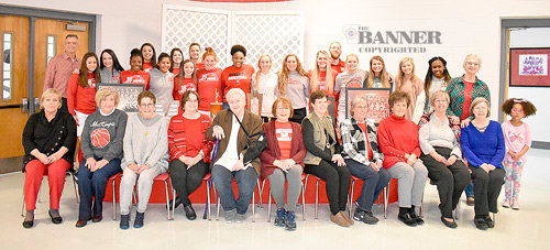 """Members of the 1960 and 1963 McKenzie Rebelettes were honored at a dinner prior to Tuesday's basketball games. The 2019-2020 Lady Rebel team stands in back. Seated in front are Rebelettes (L to R): LaRenda Bradford Scarbrough, Emily Young Archer, Pam Collins Bohanek, Glenda Coates McAlister (1963 coach), Frances Regina """"Pete"""" Russell Taylor, Diane Stoner Stafford, Kay Brown, Sally House Branon, Barbara Cozart Elinor, Karen Webb Camp, Paula Pinson Watkins (standing) and Annette Sasser Swartzlander."""