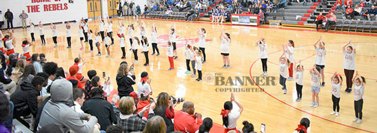 Participants in the annual Taylor Buckley Cheer Camp show what they learned with a halftime routine.