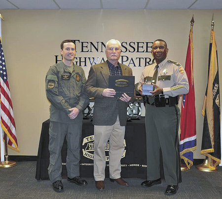 Lieutenant Steve Russell retires from the Tennessee Highway Patrol. He is pictured with his son, Sergeant Lee Russell, Lieutenant Steve Russell in the middle, and Colonel Derek Stewart of the THP.