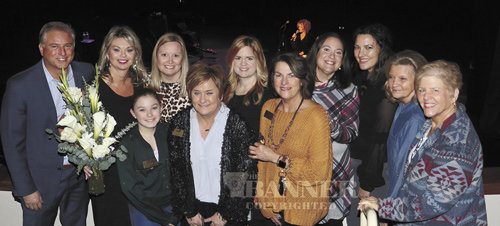 Michelle Mitchell was honored for three years of service to The Dixie Carter Performing Arts and Enrichment Center during the Lyle Lovett Concert. Mitchell served as the CEO of the Center. Pictured are: Jeffrey Plummer, Michelle Mitchell, Angela Chasse, Addison Chasse, Leigh Boxell, Aileen Davis, Trudy Radford, Megan Rushing, Rosemary Radford, Angie Bartholomew and Karen Spotnagle.