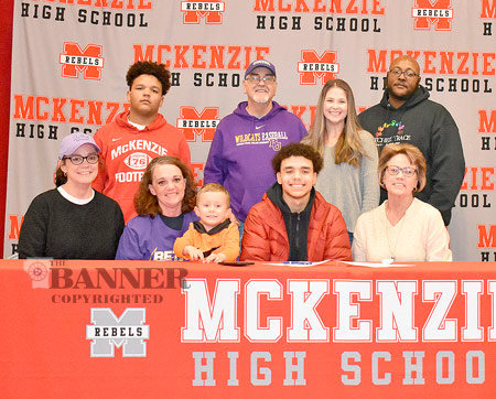 McKenzie senior Micah Austin signed with Bethel University football, surrounded by family. Pictured are (L to R): Seated — Reba Austin, Micah's aunt; Rachel Austin, his mom; River Birdwell, cousin; Micah; and Rhonda Bomar, grandmother; Standing — Elijah Edmonson, brother; Steve Bomar, grandfather; Amber Eason, girlfriend; and Kelvin Scott, mentor.