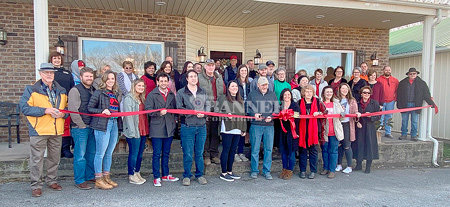 Tammy and Stacy Collins cut the ribbon to Simply Eventful along with members of the Weakley County Chamber of Commerce and governmental officials.