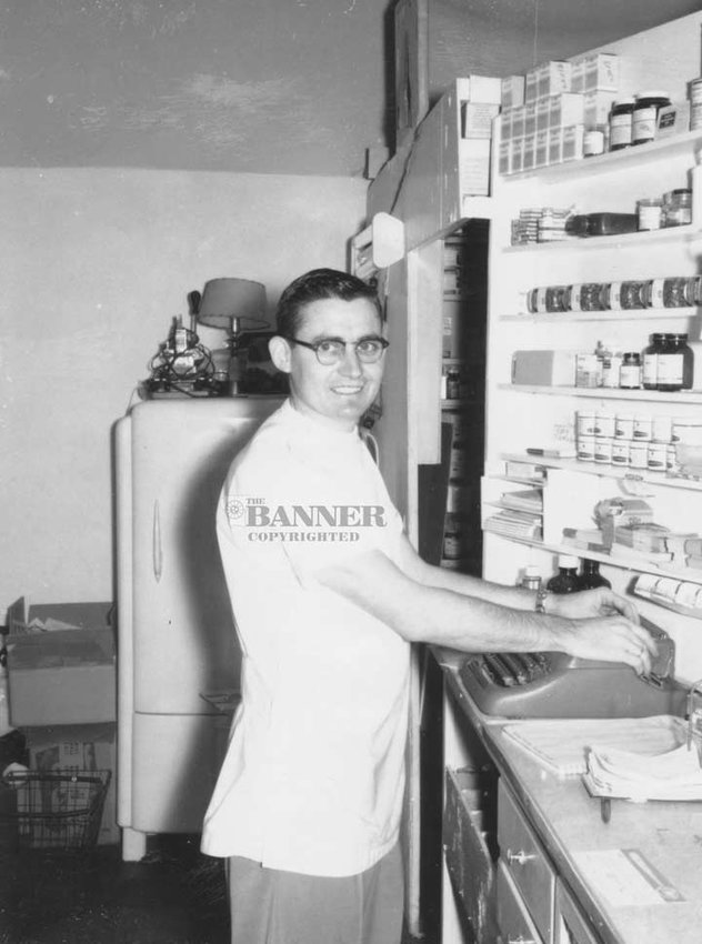 JT Lindsey behind the counter shortly after purchasing Cannon Drugs.