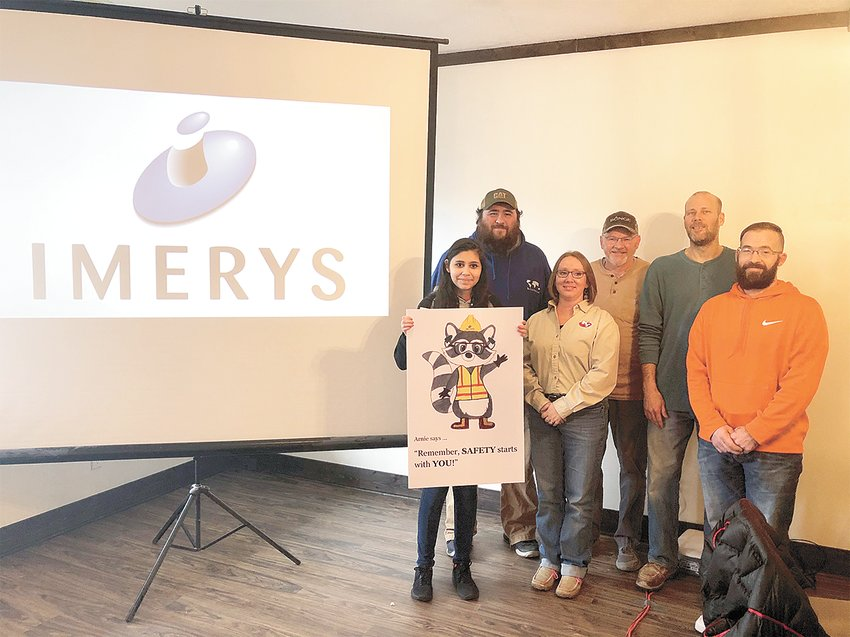 Gleason freshman Maryorie Pastrana holds Arnie, the safety mascot she created in response to a request from Imerys safety committee. Seen here are committee members (from left to right) Brian Spain, Lisa Pritchard, Stacy Collins, Eric Duke and Nick Perry.