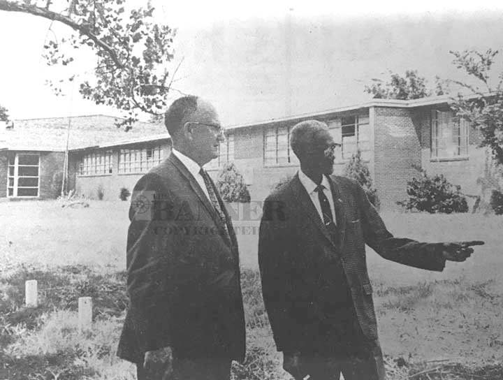 Two leaders stand in discussion: Mayor Y.D. Moore and Professor J.L. Seets of Webb School.