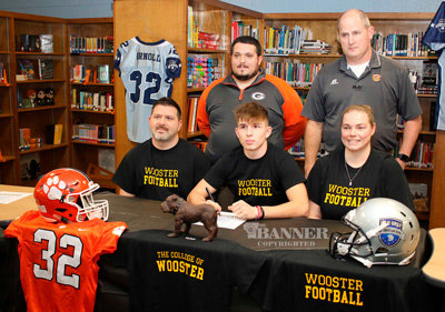 Dawson Arnold, a senior at Gleason, signed with the College of Wooster to play football next fall. Pictured (L to R): Heath Arnold (dad), Dawson Arnold, and Nena Knott (mom) and assistant coaches Albert Collins and Brian Sanders. Not Pictured: Head Gleason Coach Noah Lampkins, who was ill.