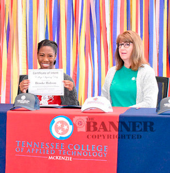 McKenzie senior Brooke Hobson signs a letter of intent to join the Administrative Office Technology program with instructor Maureen Sledd.