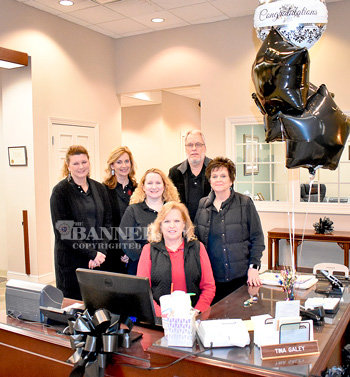 Seated is Tina Galey on her last day at the Bank of Gleason; standing are co-workers (L to R): LeAnn Sellers, Jackie Taylor, Sandra Walker, James Terrell and Charlene Snider.