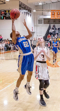 Brooklyn Williams lays up two points after a steal in the Fillies' win over Richland.