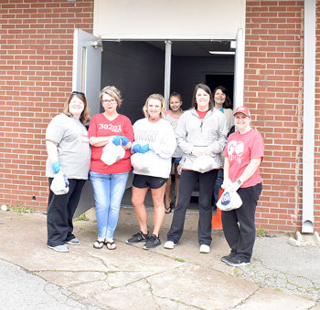 Volunteers serve meals to children Monday at McKenzie Middle School — Front Row (L to R): Mallory Welch, Cynthia Creyssells, Amy Talley, Jana Stafford and Rachel Newman. Back Row (L to R): Ava Newman and Beth Bailey.
