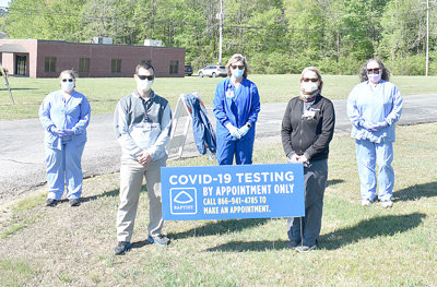 From left, Baptist-Carroll County employees Jessica Painter, LPN; Rob Eldredge, ATC; Cindy Cole, RN; Sheilla Deaton, PTA; and Tina Simpson, CST help run the site, organizing procedures, directing patients and supervising and ensuring safety protocols.