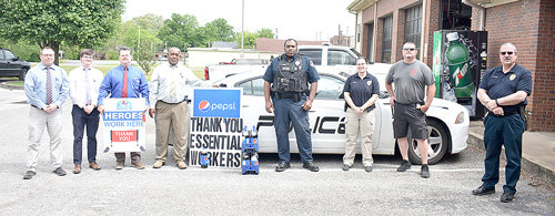 McKenzie (April 28) — Representatives from Pepsi MidAmerica visited city hall Tuesday to donate drinks to the police and fire departments in appreciation for their service. Pictured are (L to R): Robert Wyatt, area sales manager; Joshua Dyer, human resources manager; Stephen Berryman, KY-TN on-premise representative; Ricky Price, division general manager; Patrolman Billy King, MPD; Investigator Jasmin Powell, MPD; Assistant Fire Chief Roger Christian, MFD; and Chief Craig Moates, MPD.