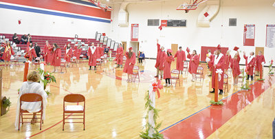 Clarksburg graduates toss their mortarboards in celebration.