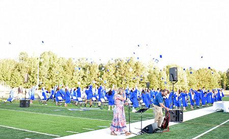 Huntingdon graduates toss their mortarboards in celebration.