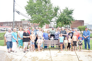 Lisa and Ryan Griffin, parents of the late Lila Griffin, along with extended family, Mayor Jill Holland and City Recorder Jennifer Waldrup, dedicated a bench Saturday in her memory at the splash pad.