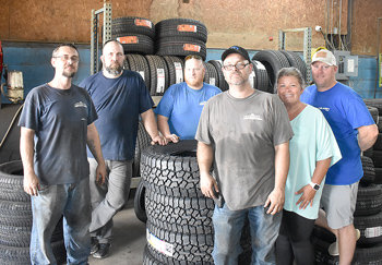 """McKENZIE (July 17) — Anderson Tires and Alignment, 126 Oak Street, celebrated five years of service Friday with a customer appreciation luncheon. Customers were invited to the business for lunch provided by Big Daddy's BBQ, along with drawings and giveaways. Autumn Anderson, bookkeeper and wife of owner Joey Anderson, told The Banner, """"We appreciate the five years of business and continued support from all around the area. We're happy to provide our services to individuals, farmers and public services. We also appreciate our wonderful staff, and hope for many more years of service to the community."""" Pictured are the Anderson Tires staff (L to R): tire technicians Adam Ezell and Josh Vowell, store manager Brandon Sampson, tire technician Casey Ezell, bookkeeper Autumn Anderson and owner Joey Anderson."""