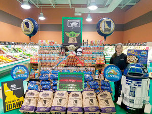 E.W. James produce manager Kristie Wainscott with her Honorable Mention-winning display in February.