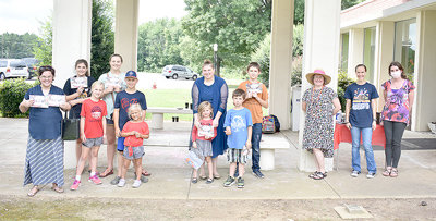 Summer readers gathered at the Back-to-School Bash for socially-distanced activities. Pictured are (L to R): Anna Moore; Kaki, June, Johannah, Haven and Charlie Dillahunty; Delilah, Rose and Will Arnold; Cole Petty; Jennifer Thornton, Carroll County Library director; Grace Hawkins, children's librarian; and Robyn Hatler, library board member and Carroll County Health Department public health educator.