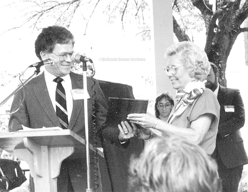 Mayor Joe Morris presented Virginia Claire Edwards a plaque of recognition during dedication services for the gazebo in the downtown park during Homecoming '86 festivities.