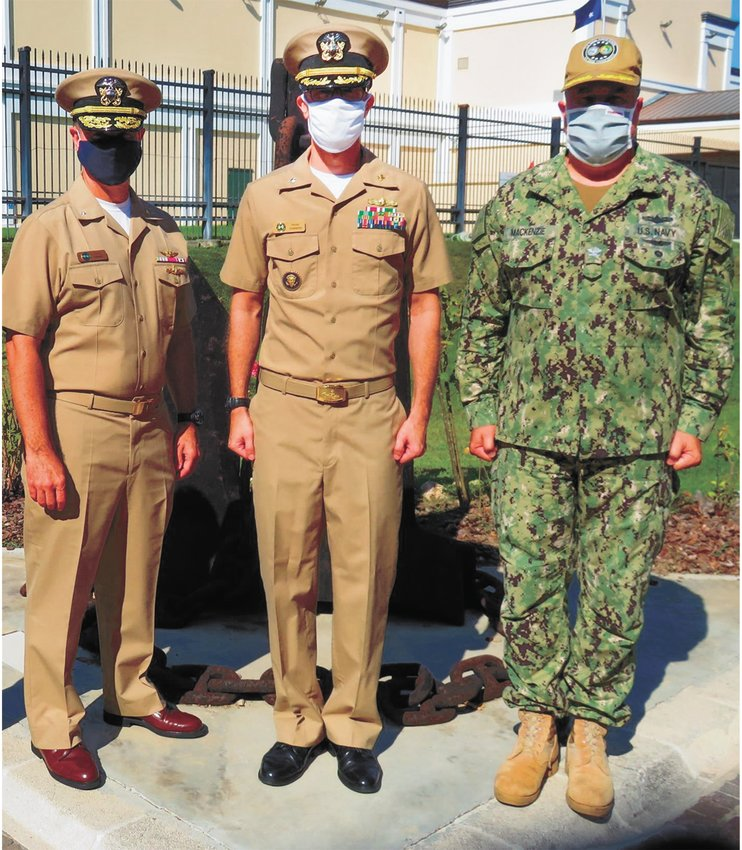 (L to R) RDML Mike Curran (provided the oath), CDR Brent Summers, and CAPT Doug MacKenzie (pinned on new rank).