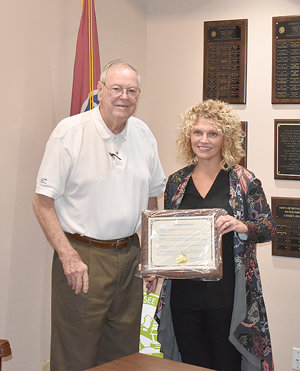Lori Nolen (right) was commended by the Huntingdon Town Council and presented a plaque by Mayor Dale Kelley. Nolen recently left her position as executive director of The Dixie after more than a decade.