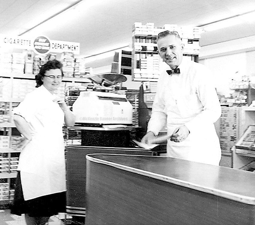 Laverne and Harris Drewry, owners of Drewry's Food Center on Cedar St. in McKenzie. This was the first supermarket in McKenzie (1960). Harris' brother, Jack Drewry, was a founder of the store along with Laverne and Harris. They later bought out his ownership.