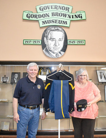 Col. Joe Parker (left) and Jennifer Waldrup donated their great-grandfather's Army uniform from the Spanish-American War to the Gordon Browning Museum.