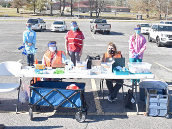 Carroll County Health Department employees provide free flu shots at Thursday's event (L to R): Seated — Kayla Campoy and Kim Garner; Standing — Virginia Douglass, Anna Todd and Allie Simpson.