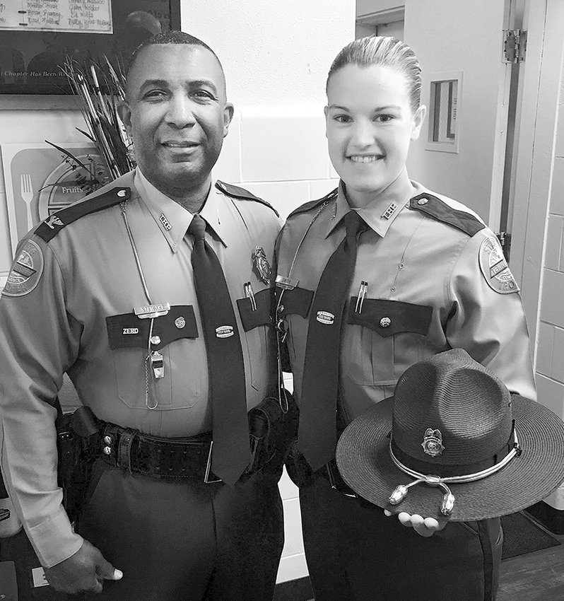 Colonel Dereck Stewart of the THP with Brenna Smith, a new member of the Tennessee Highway Patrol. Both are from McKenzie.