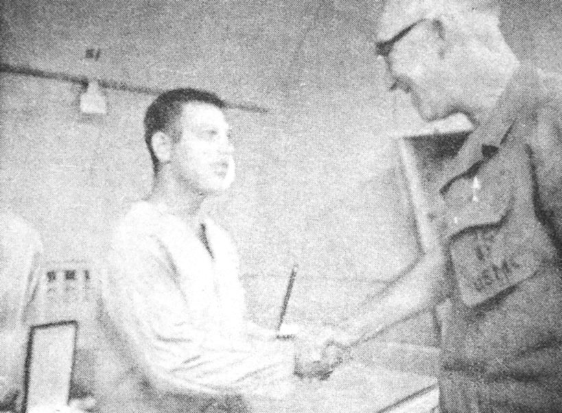 Pfc Tommy Hopper shaking hands with a General after receiving his second purple heart (1968 Vietnam).