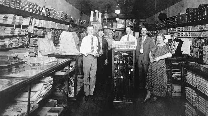 Bobo's Store, 1922 (L to R); Mrs. Erma Heath, Walton James, Graden Featherstone, Fred Ragland, Gordon Finley, J. D. Featherstone, Emma Marshall.