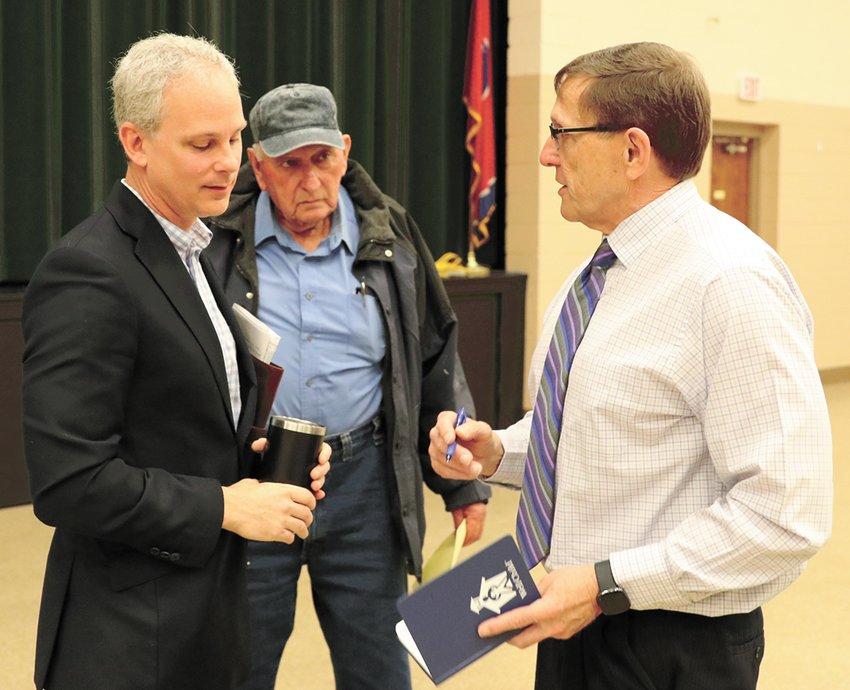 David Duncan, director of Hollow Rock-Bruceton School, speaks with Senator John Stevens (left) as County Commissioner John Mann awaits his turn to speak with the senator.
