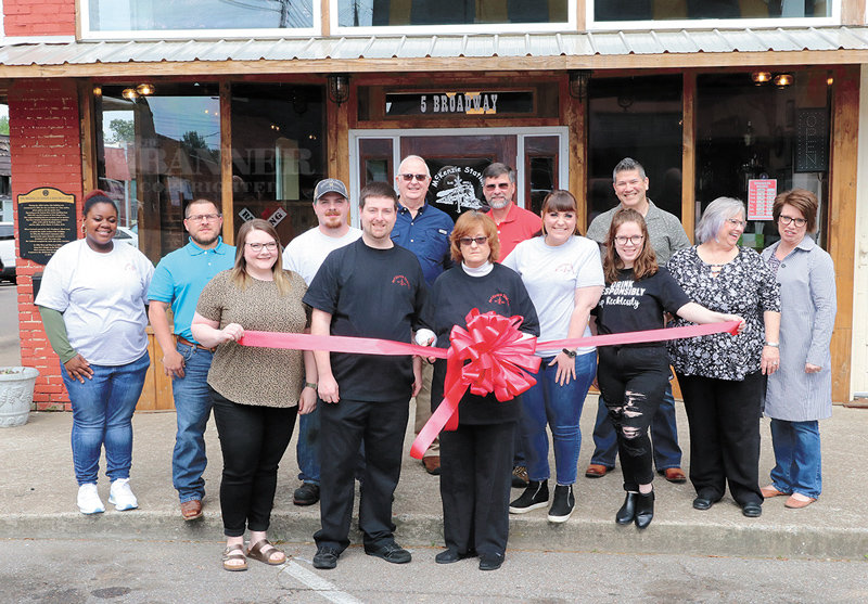 Pictured cutting the ribbon is Denise Sam, joined by General Manager Brad Sam.