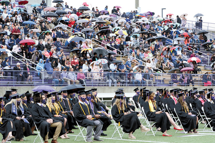 An early rain drizzle brought out the umbrellas. The precipitation soon passed and the graduates and attendees enjoyed the commencement exercises.