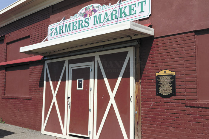 McKenzie Farmers' Market opens Saturday for the 2021 season. The historic building, once an automotive dealership, air conditioner business, and florist, is an indoor market. Some vendors set up outside with their products.