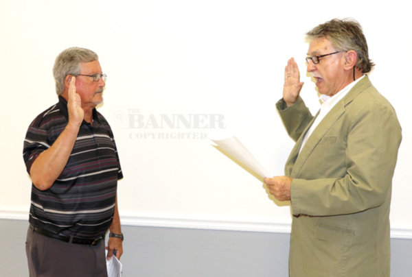 Don Barger (left) was administered the oath of office by Charlie Trotter, city attorney.