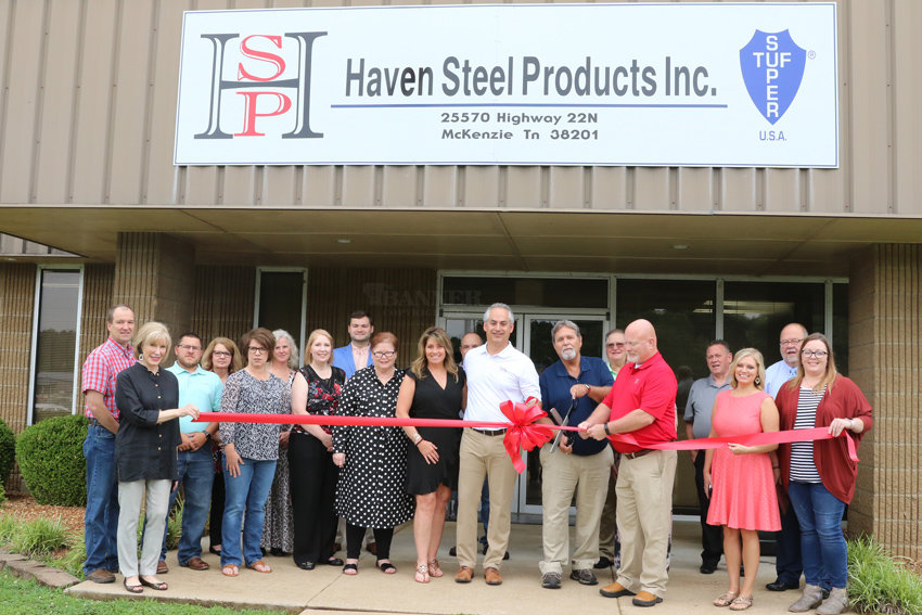 Haven Steel President Ken Brown and his wife, Alison, Bob Dennison, Tom O'Brien, members of the Carroll County Chamber of Commerce and members of the McKenzie Chamber of Commerce attended Haven Steel's ribbon cutting ceremony. Bob Dennison, general plant manager of McKenzie's Haven Steel plant, cut the ribbon.