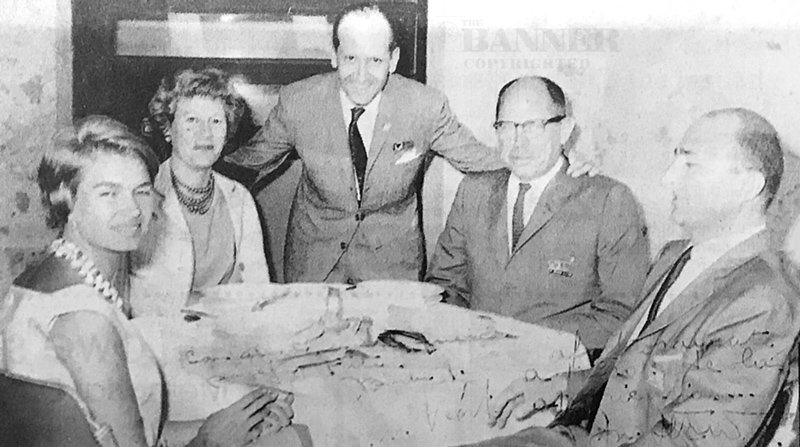 George and Carolyn Fite (second and fourth from the left) dine with international friends.