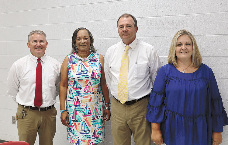 Principals Kelly Spivey from McKenzie High School, Dorothea Royle from McKenzie Middle School and Tanya Brown from McKenzie Elementary School are pictured with Director of Schools Lynn Watkins.