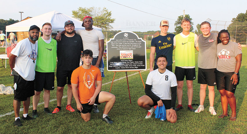 After the reunion game, the class of 2020 boys' soccer team was presented with a plaque honoring their lost season. Back Row: Coach Jeremy Bilger, Deven Fields, Jack Fry, Nathan Whitsell, Nikolas Heath, Jensen Pewitt, Ashton Marr and Coach Karlene Brown. Front Row: Francisco Padilla and Daniel Gonzales.
