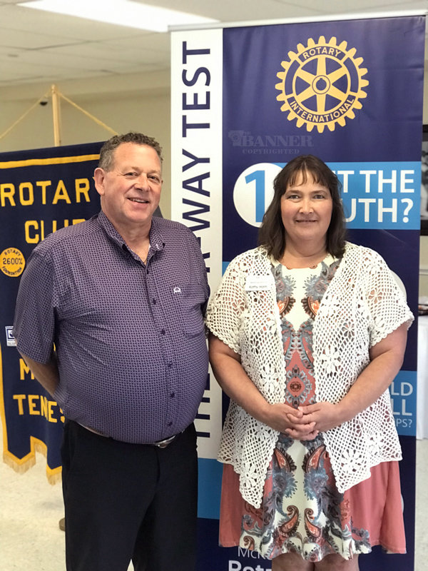 Armand Hebert (left) of Hebert Consulting with club vice president Kathy Ham (right).