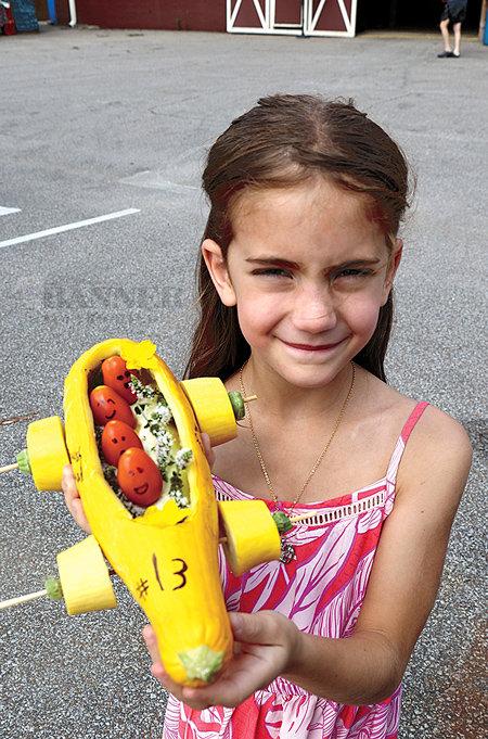 Olivia Fontana displays her Squash Squad vehicle.