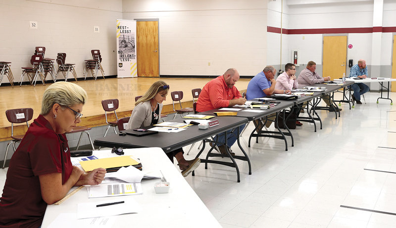 West Carroll School Board reviews the 2021-22 budget before passage. Pictured (L to R) Kimberly Smith, Misty Mitchell, Jeremy Jackson, William Robinson, Christopher Hayden (attorney), Patrick Lindsey and David Hilliard.