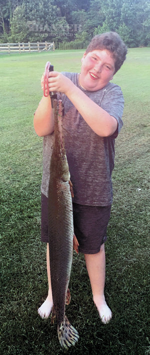 Garyn Hilburn, 11, Bruceton, the son of Teresa (David) Cawthon and Wayne (Andrea) Hilburn. He was fishing with his dad on July 10, 2021 and caught a long nosed Gar, 18-pound, 54-inch near Fort Pillow, at Cold Creek in Tenn. Garyn will attend Camden Jr High School, and is in sixth grade this fall.