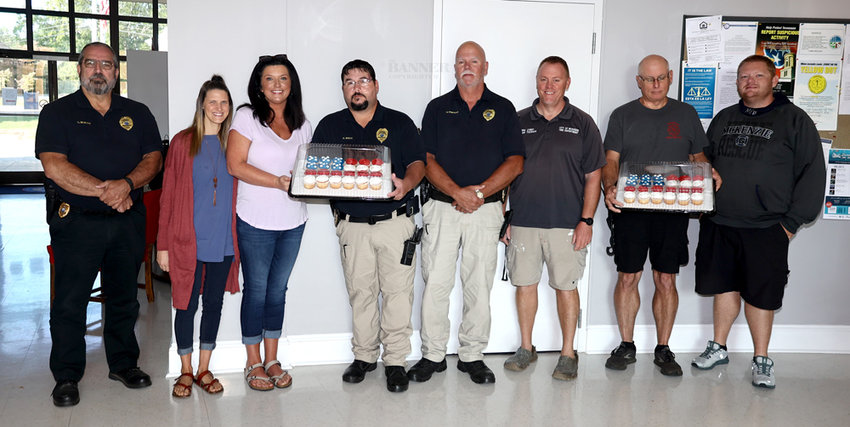 Cash Express honored first responders with cupcakes on the anniversary of the September 11, 2001 terrorist attacks on the country. Pictured are Police Chief Craig Moates, Rebecca Barmore and Monica Brogdon with Cash Express, Lieutenant Ryan White, Assistant Chief Rick Sawyers, Fire Chief Brian Tucker, Fire Lt. Robert Ross, and Battalion Chief Jason Arnold.