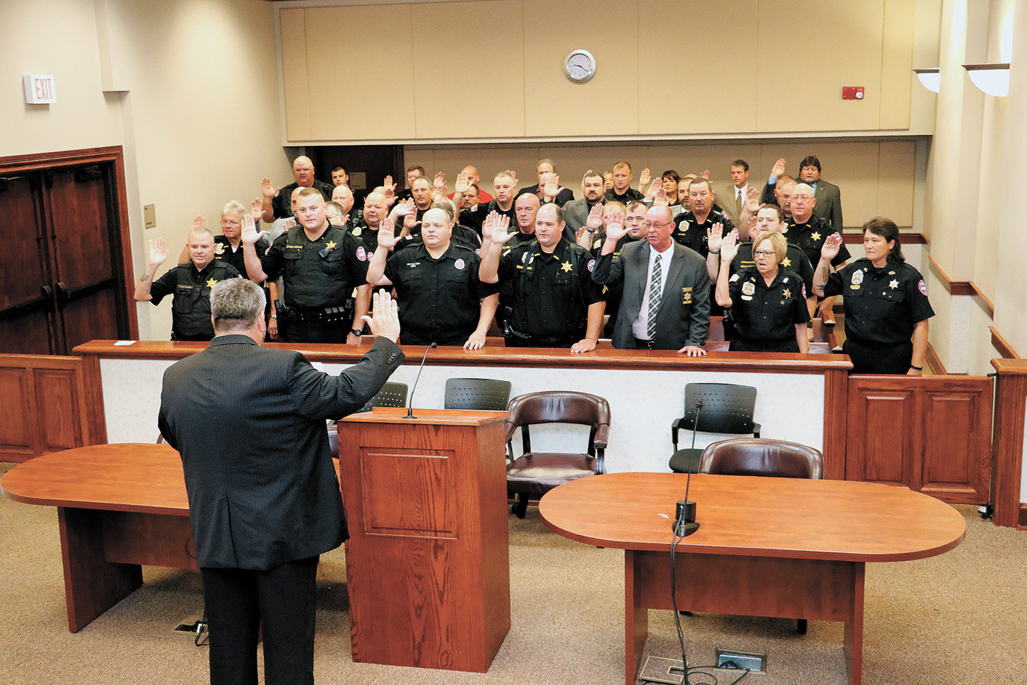 Sheriff Andy Dickson administers the oath of office to his deputies and staff.